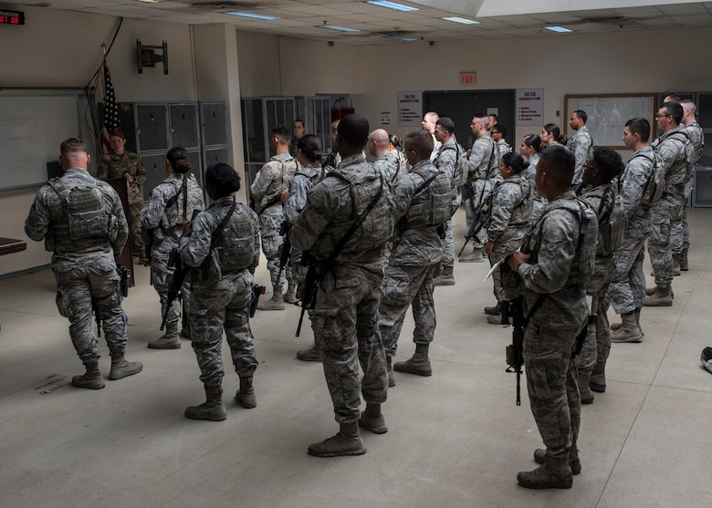 U.S. Air Force members assigned to the 39th Security Forces Squadron contingency operations, receive a briefing during guard mount at Incirlik Air Base, Turkey, July 26, 2018.