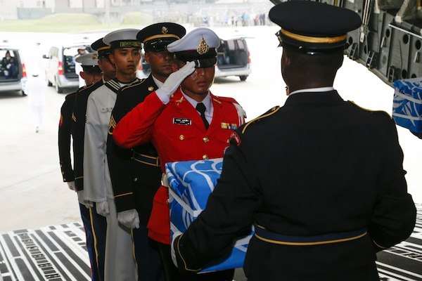 United Nations Honor Guard members carry the remains of fallen service members during a dignified return ceremony at Osan Air Base, South Korea, July 27, 2018. Members of the command and the Osan community were on hand at the arrival ceremony. Army photo by Sgt. Quince Lanford