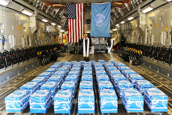 United Nations Command Chaplain Army Col. Sam Lee performs a blessing of sacrifice and remembrance on the 55 cases of remains returned by North Korea at Osan Air Base, South Korea, July 27, 2018. Army photo by Sgt. Quince Lanford