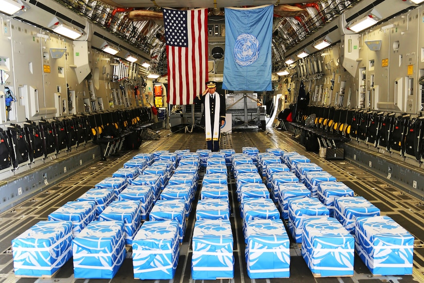 United Nations Command Chaplain Army Col. Sam Lee performs a blessing of sacrifice and remembrance on the 55 cases of remains.