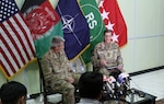 KABUL, Afghanistan (July 23, 2018) -- Gen. John Nicholson, Resolute Support commander, and Gen. Joseph Votel, U.S. Central Command commander, speak with media during a press conference at Resolute Support headquarters, July 23. (NATO photo by Erickson Barnes)