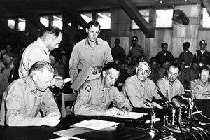 Army Gen. Mark W. Clark signs the Korean War Armistice agreement .