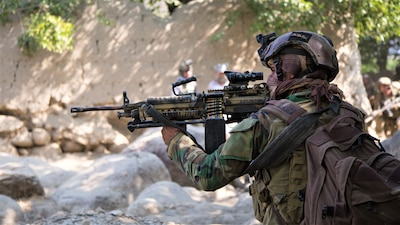 NANGARHAR, Afghanistan (July 22, 2018) – An Afghan Special Security Forces member pauses during a patrol after conducting a raid that killed Mullah Nasim Mushfaq, Taliban shadow governor of Kapisa, and Qari Ehsanullah, Taliban district shadow governor of Tagab, July 22, 2018.  (NATO photo by Spc. Casey Dinnison)
