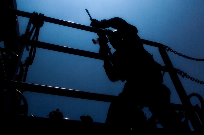 A reconnaissance Marine with the 31st Marine Expeditionary Unit's Force Reconnaissance Platoon searches for potential threats aboard a U.S. Army landing craft during a combined sea and airborne Visit, Board, Search and Seizure exercise as part of Realistic Urban Training Exercise, off the coast of Okinawa, Japan, July 26, 2017. Reconnaissance Marines with FPR boarded the landing craft from hovering aircraft while other teams raided the target vessel from small, inflatable rubber boats, known as Combat Rubber Raiding Craft. The 31st MEU, the Marine Corps' only continuously forward-deployed MEU, provides a flexible force ready to perform a wide-range of military operations across the Indo-Pacific region. The 31st MEU, the Marine Corps' only continuously forward-deployed MEU, provides a flexible force ready to perform a wide-range of military operations across the Indo-Pacific region.
