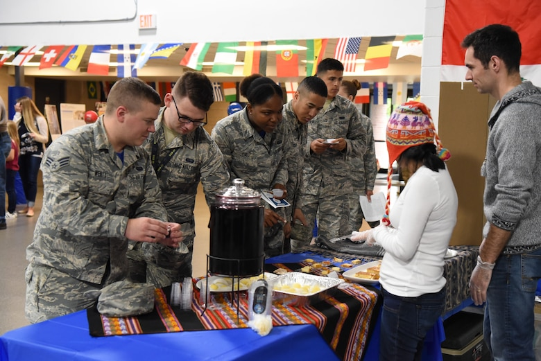 Airmen gather to sample food at the multicultural expo June 20, 2018, at Grand Forks Air Force Base, North Dakota. Each booth had a dish from their respective culture, so that base residents could try out different tastes from all over the world. (U.S. Air Force photo by Airman 1st Class Melody Wolff)