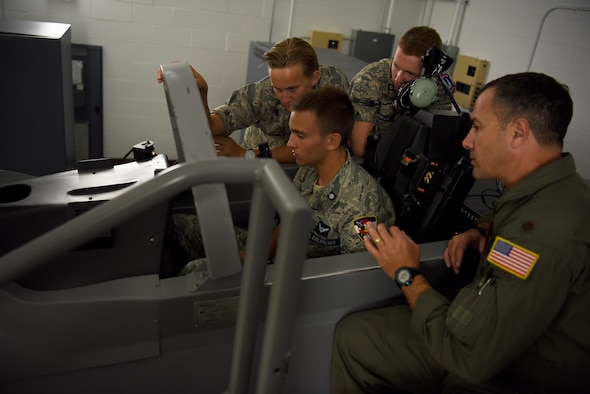 Maj. Art Richardson, Civil Air Patrol SUPT Familiarization course instructor, teaches Civil Air Patrol cadets while flying a T-6 Texan II simulator July 24, 2018, on Columbus Air Force Base, Mississippi. Through three phases student pilots will learn everything they must know to begin their journey as the most professional military aviators in the world, and every year the Civil Air Patrol have 10 days to live in a simulated SUPT program. (U.S. Air Force photo by Airman 1st Class Keith Holcomb)