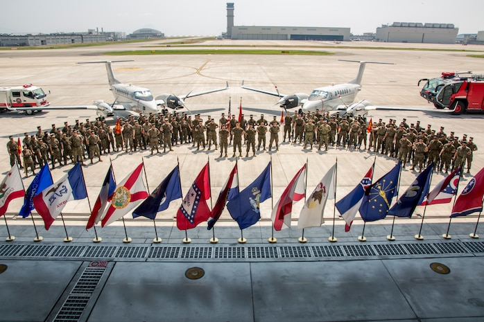U.S. Marines with Headquarters and Headquarters Squadron gather together for a photo at Marine Corps Air Station Iwakuni, Japan, July 26, 2018. U.S. Marine Corps Lt. Col. Kevin Campbell, former commanding officer of Headquarters and Headquarters Squadron, relinquished his command to Lt. Col. Jason Kaufmann, commanding officer of H&HS during a change of command ceremony.