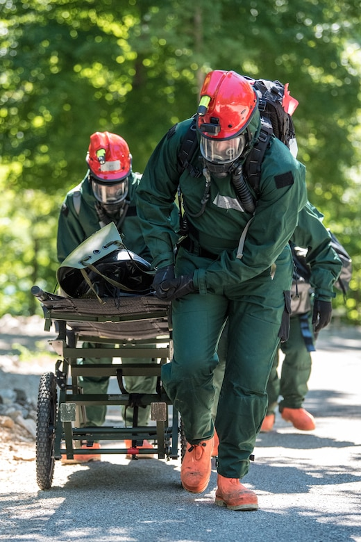 Airmen from the Kentucky Air National Guard's Fatality Search and Recovery Team move a training mannequin with a gurney during a training exercise at Rough River State Resort Park in Falls of Rough, Ky., on July 18, 2018. Thirteen members of the 123rd Airlift Wing participated in the three-day exercise to simulate the recovery and repatriation of fallen service members. (U.S. Air National Guard photo by Master Sgt. Phil Speck)