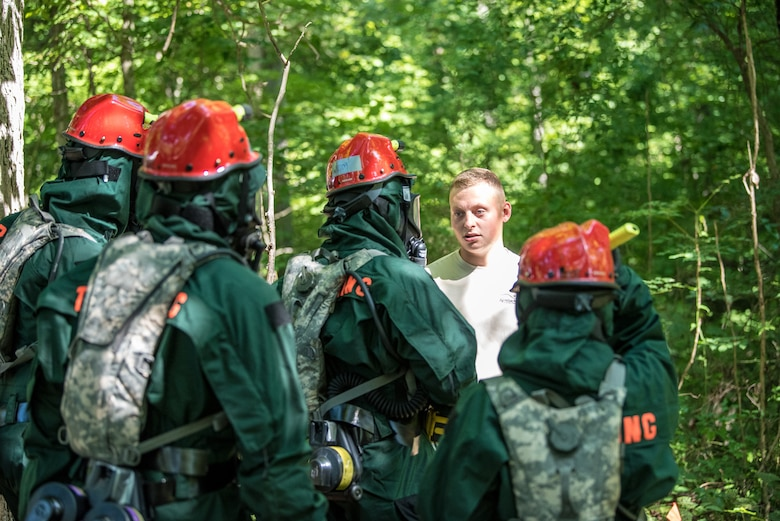 Senior Airman Parker Hale, a member of the Kentucky Air National Guard's Fatality Search and Recovery Team, briefs FSRT members before a training exercise at Rough River State Resort Park in Falls of Rough, Ky., on July 18, 2018. Thirteen members of the 123rd Airlift Wing participated in the three-day exercise to simulate the recovery and repatriation of fallen service members. (U.S. Air National Guard photo by Master Sgt. Phil Speck)
