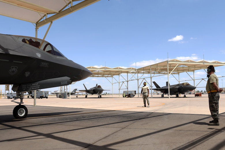 61st Aircraft Maintenance Unit maintainers prepare to taxi-out a 61st Fighter Squadron F-35A Lightning II for a transitional training sortie July 18, 2018, at Luke Air Force Base, Ariz. The 61st FS flies sorties daily as part of routine flight training operations. (U.S. Air Force photo by Senior Airman Ridge Shan)