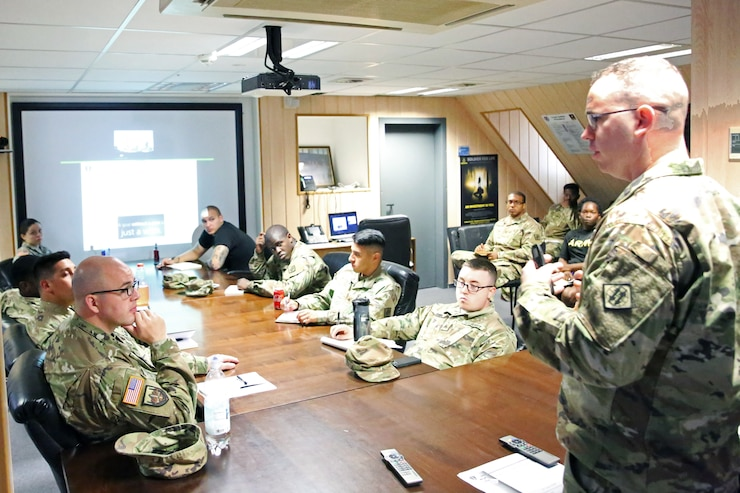 Soldiers at conference table