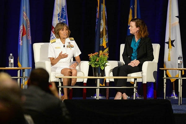 Navy Vice Adm. Raquel C. Bono, director of the Defense Health Agency, and Stacy Cummings, program executive officer for Defense Health Management Systems, answer questions about the progress of MHS GENESIS electronic health record, during the 2018 Defense Health Information Technology Symposium in Orlando, Florida, July 24.