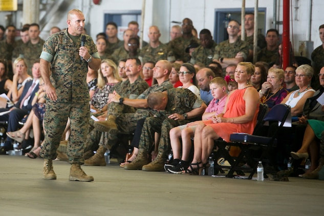 Col. Frank Latt, the outgoing commanding officer of Marine Aircraft Group 31, addresses the crowd during a change of command ceremony aboard Marine Corps Air Station Beaufort July 19. Latt relinquished command of Marine Aircraft Group 31 to Col. Matthew H. Phares after commanding MAG-31 for 17 months.