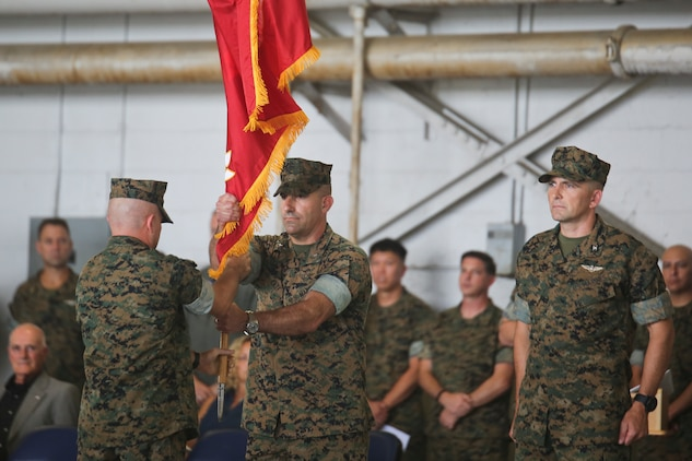 Col. Frank N. Latt relinquishes command of Marine Aircraft Group 31 to Col. Matthew H. Phares aboard Marine Corps Air Station Beaufort July 19. Latt commanded MAG-31 for 17 months before passing on the unit colors to Phares. Previously Phares was assigned to the staff of 2nd Marine Aircraft Wing.
