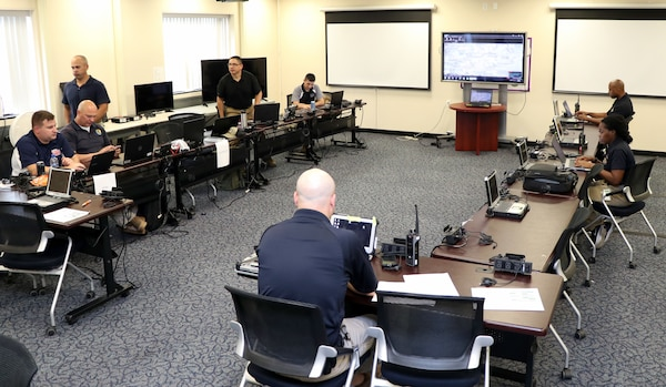Members of the District of Columbia National Guard's 33rd Civil Support Team and Delaware's 31st CST, man the joint operations center on July 17, 2018, at the D.C. Armory in Washington, D.C. The JOC was the center for operations during the 33rd and 31st CSTs mobilization for the 2018 MLB All-Star Game at Nationals Park. (screens have been blurred) (U.S. Army National Guard photo by Kevin Valentine/released)