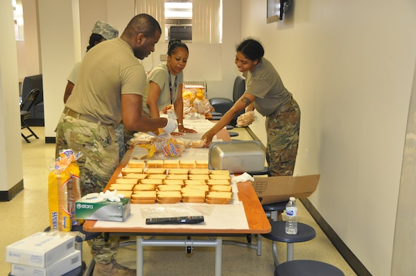 Members of the D.C. National Guard's 372nd Military Police Battalion prepare bag lunches for Soldiers on duty for July 4th mission