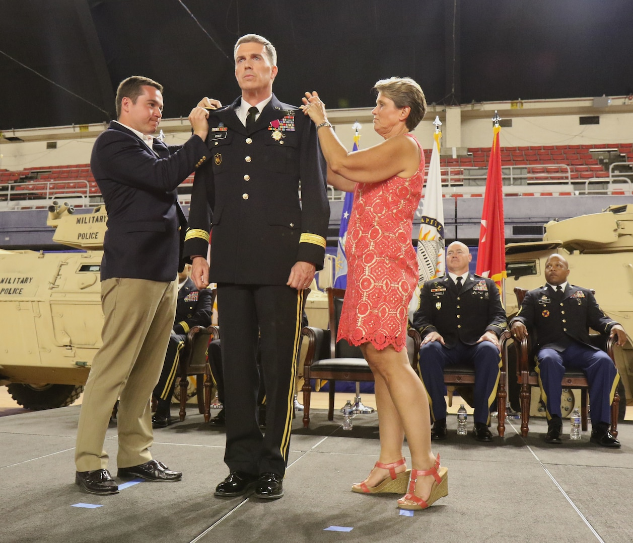 WASHINGTON- Members of Col. Robert K. Ryan's family pin on his new rank of brigadier general during a ceremony, June 10, 2018 at the District of Columbia Armory. Ryan is appointed Commander, Land Component Command, D.C. Army National Guard and will be responsible for strategic leadership and policies that affect all Army Soldiers in the D.C. National Guard, and for mission readiness of units assigned to the Land Component Command. (U.S. Army National Guard photo by Sgt. Adrian Shelton/Released)