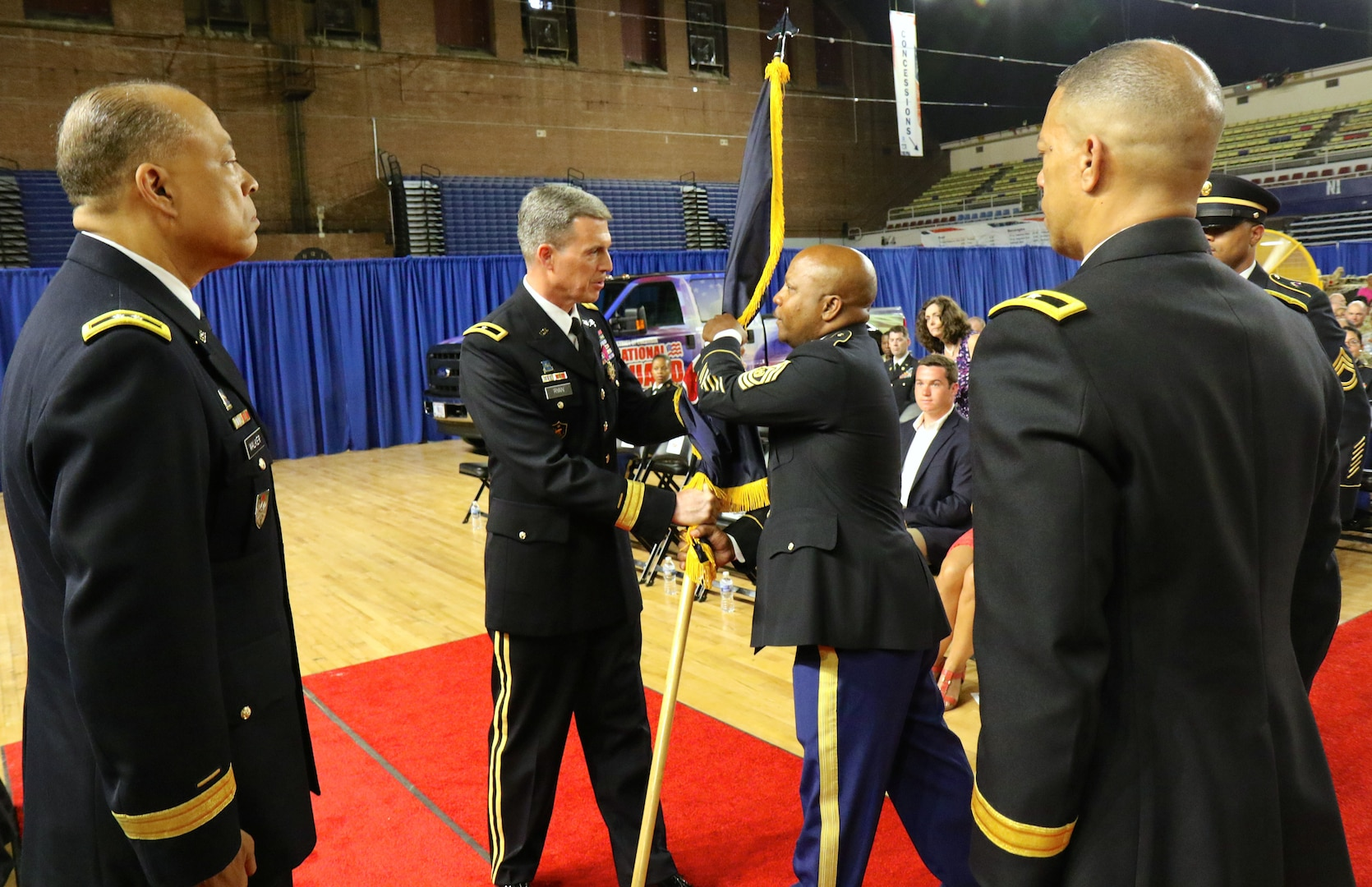 WASHINGTON - Brig. Gen. Robert K. Ryan passes the Land Component Command (LCC) flag to Command Sgt. Maj. Terrance A. Smith during the change of responsibility ceremony, June 10, 2018 at the District of Columbia Armory. Smith assumes responsibility as the new LCC command sergeant major, the top enlisted leader of Soldiers in units assigned to the LCC, and will ensure their readiness for all federal and district response missions in support of civil authorities. (U.S. Army National Guard photo by Sgt. Adrian Shelton/Released)
