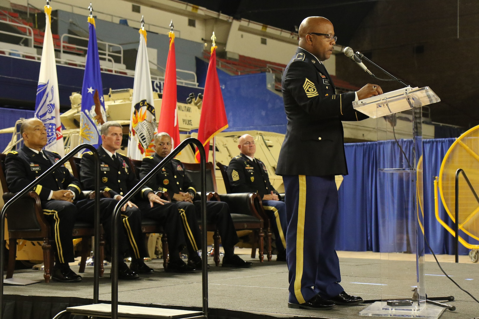 WASHINGTON- Command Sgt. Maj. Terrance A. Smith addresses Soldiers during the Land Component Command (LCC) change of responsibility ceremony, June 10, 2018 at the District of Columbia Armory. Smith will serve as an enlisted adviser to Brig. Gen. Robert K. Ryan, Commander, LCC, D.C. National Guard. (U.S. Army National Guard photo by Sgt. Adrian Shelton/Released)