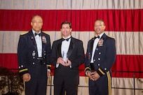 Dr. Mark T. Esper, 23rd Secretary of the U.S. Army, assisted by Airman 1st Class Alejandro Irizarry-Cortes and Pfc. Monique Jones, cut the District of Columbia National Guard's birthday cake, during the DCNG Military Ball at the DCNG Armory, May 5, 2018. The ball was held in the first week of May to commemorate the establishment of the DCNG on May 3, 1802. (U.S. Army photo by Daniel Torok)
