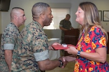 Nancy Johnson, Customer Support Specialist, is recognized for her 30 years of faithful service as a Civilian Marine during the quarterly awards breakfast aboard Marine Corps Logistics Base Barstow, Calif., July 17.