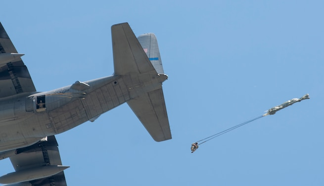 Joint force members from six bases performed static-line and free-fall jumps over the Scott Air Force Base drop zone July 18.