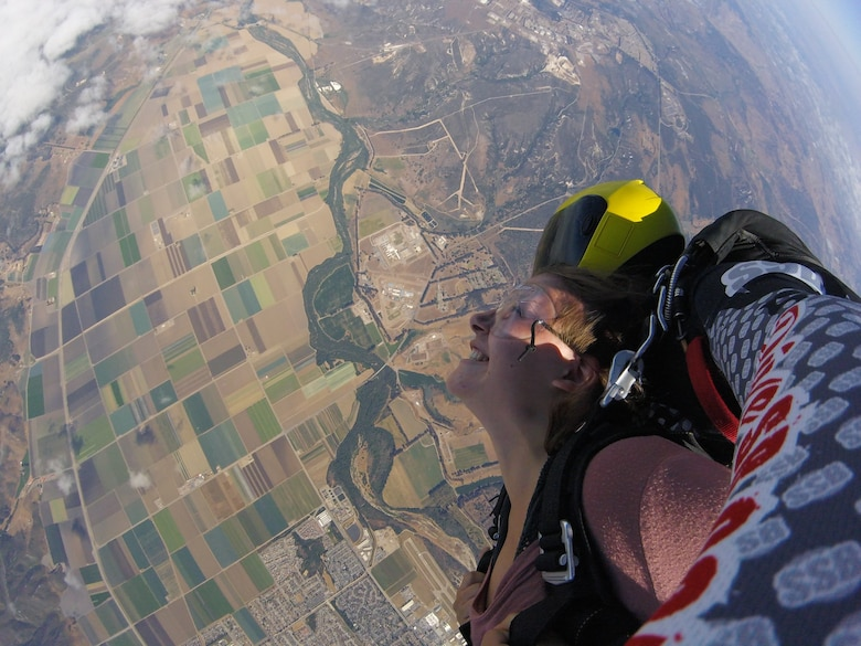 Airman First Class Aubree Milks, 30th Public Affairs photojournalist, gravitates towards the earth July 21, 2018 at Skydive Santa Barbara, Lompoc, Calif. Milks soars through the air from 13,000 feet, untouched by a thing. (Complimentary photo)