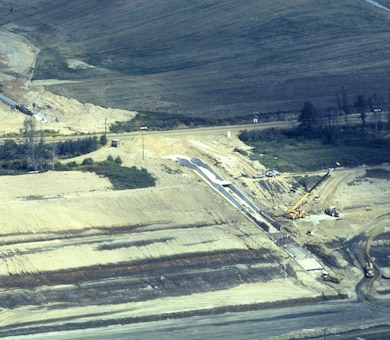 This is an aerial view of the Tennessee-Tombigbee Waterway under construction Sept. 4, 1981. The U.S. Army Corps of Engineers Nashville District built the northern 29 miles of the project, including the massive 27-mile divide cut, which connected the waterway with Pickwick Lake on the Tennessee River. (USACE Photo)