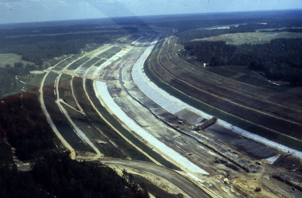 This is an aerial view of the Tennessee-Tombigbee Waterway under construction Sept. 12, 1981. The U.S. Army Corps of Engineers Nashville District built the northern 29 miles of the project, including the massive 27-mile divide cut, which connected the waterway with Pickwick Lake on the Tennessee River. (USACE Photo)