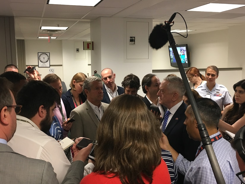 Defense Secretary James N. Mattis, center right, meets with reporters and takes their questions in the Pentagon.