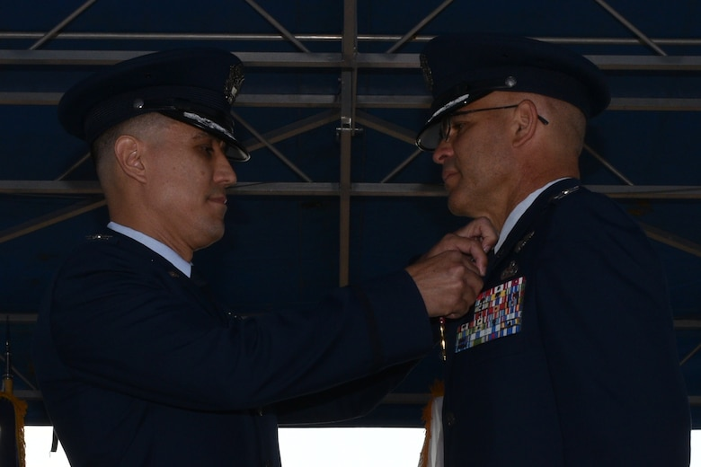 U.S. Air Force Col. Ricky Mills, 17th Training Wing commander, pins a Legion of Merit medal to Col. Alex Ganster, 17th Training Group outgoing commander, during the 17th TRG Change of Command on the parade field on Goodfellow Air Force Base, Texas, July 27, 2018. The Legion of Merit is an award given for exceptionally meritorious conduct in the performance of outstanding services and achievements. (U.S. Air Force photo by Senior Airman Randall Moose/Released)