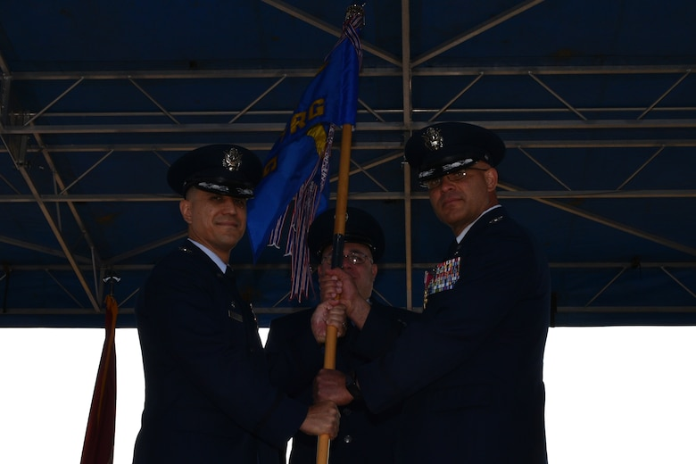 U.S. Air Force Col. Ricky Mills, 17th Training Wing commander, receives the 17th Training Group guideon from Col. Alex Ganster, 17th TRG outgoing commander, during the 17th TRG Change of Command on the parade field on Goodfellow Air Force Base, Texas, July 27, 2018. Ganster served as the 17th TRG commander from 2016 to 2018. (U.S. Air Force photo by Senior Airman Randall Moose/Released)
