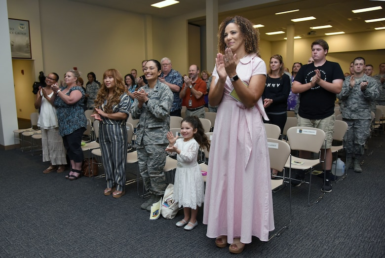 Keesler personnel, families and friends attend the 338th Training Squadron change of command ceremony in the Roberts Consolidated Aircraft Maintenance Facility at Keesler Air Force Base, Mississippi, July 26, 2018. U.S. Air Force Lt. Col. Andre Johnson, incoming 338th TRS commander, assumed command from Lt. Col. Michael Zink, outgoing 338th TRS commander. (U.S. Air Force photo by Kemberly Groue)