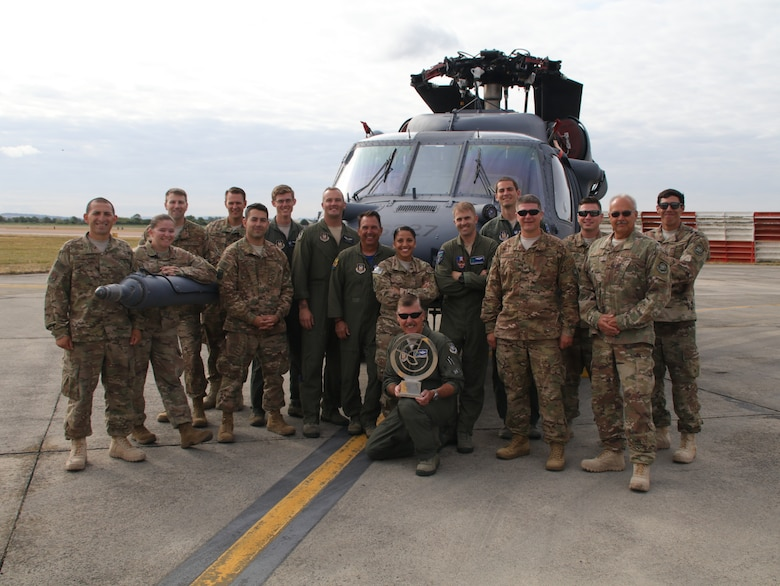 The 2018 Royal International Air Tattoo, the world's largest air show, selected an HH-60G Pave Hawk helicopter from the 943rd Rescue Group, Tucson, Ariz., as the winner of best static display out of hundreds of aircraft July 14. Along with the 943rd RQG commander, Col. John Beatty, maintenance and operations Airmen posed with the trophy and the winning aircraft at the tattoo for their roles in taking the win. The international 100-year celebration boasted 302 aircraft from 43 air arms representing 30 nations, which drew a crowd of more than 185,000 from July 13 – 15. (U.S. Air Force photo by Master Sgt. Brock Woodward)
