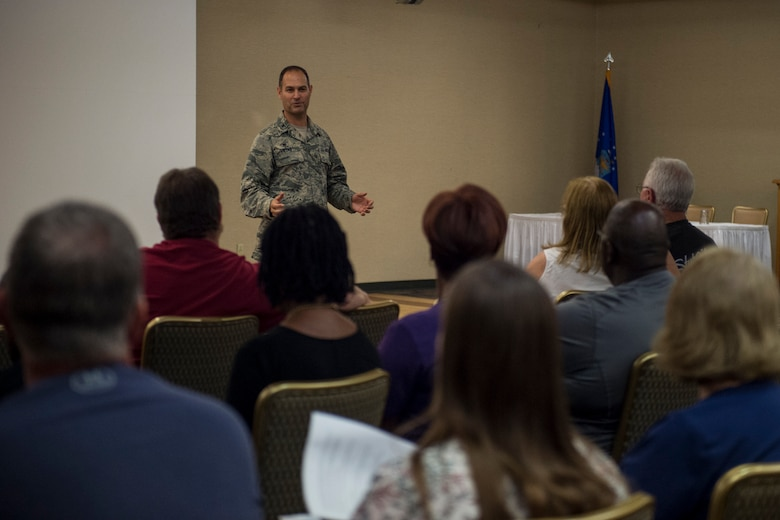 Col. Jay Vietas, 23d Medical Group commander, addresses retirees during a medical benefits town hall, July 26, 2018, at Moody Air Force Base, Ga. In order to align with a recent Air Force Medical Service policy update, the 23d Medical Group is slated to reassign approximately 1,560 retirees and their dependents to off-base TRICARE providers, on Aug. 17, 2018.