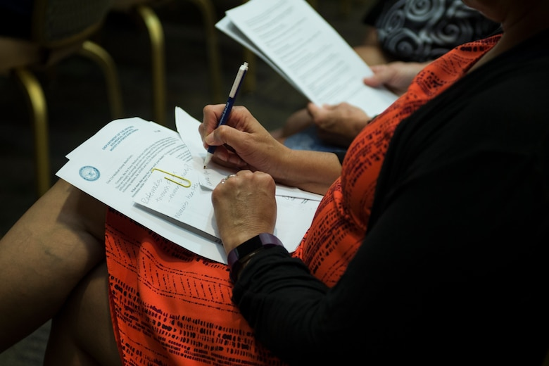A retiree takes notes during a medical benefits town hall, July 26, 2018, at Moody Air Force Base, Ga. In order to align with a recent Air Force Medical Service policy update, the 23d Medical Group is slated to reassign approximately 1,560 retirees and their dependents to off-base TRICARE providers, on Aug. 17, 2018. (U.S. Air Force photo by Andrea Jenkins)