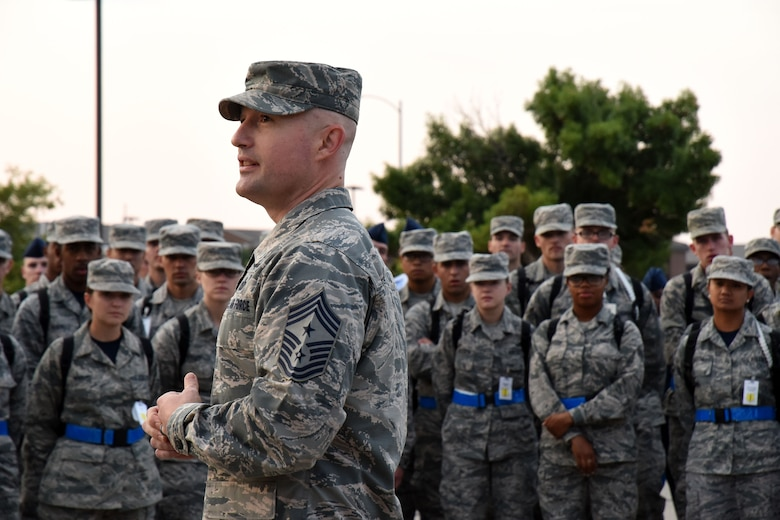 U.S. Air Force Chief Master Sgt. Stefan Blazier, 363rd Intelligence, Surveillance and Reconnaissance Wing command chief, briefs Airman from the 315th Training Squadron during morning formation near Carswell Field House on Goodfellow Air Force Base, Texas, July 27, 2018. Blazier was able to visit Goodfellow and talk with students about where they may be stationed within the 363rd ISRW. (U.S. Air Force photo by Airman 1st Class Seraiah Hines/Released)