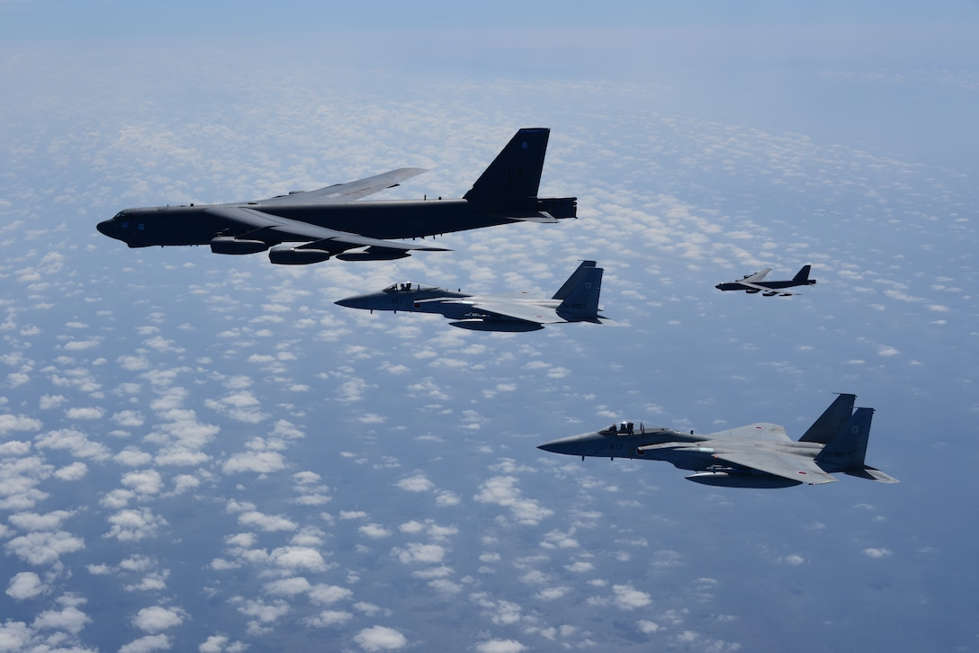 Two U.S. Air Force B-52H Stratofortress bombers and two Koku Jieitai (Japan Air Self-Defense Force) F-15 fighters execute a routine bilateral training mission in the vicinity of Japan, July 26, 2018.  This mission was flown in support of U.S. Indo-Pacific Command's Continuous Bomber Presence (CBP) operations, which are a key component to improving combined and joint service interoperability. Bilateral training missions such as this allow the two countries to improve upon combined capabilities, tactical skills, and relationships. (Courtesy Photo)
