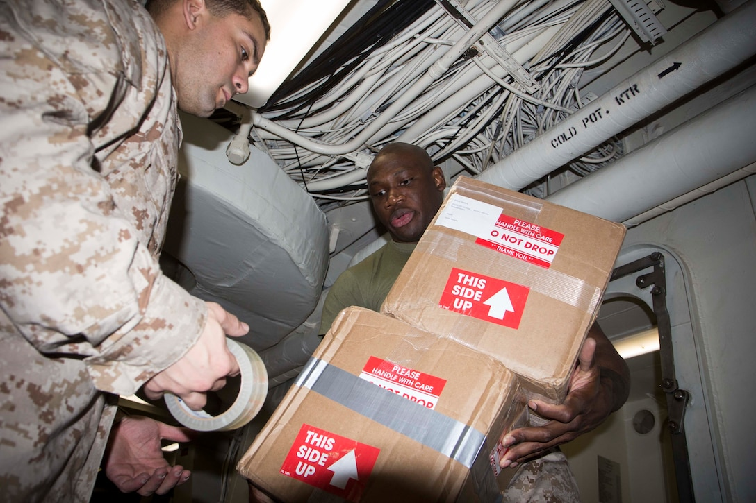 MEDITERRANEAN SEA (May 15, 2018) Marines and Sailors aboard the San Antonio-class amphibious transport dock USS New York (LPD 21) organize mail May 15, 2018. The New York receives mail during replenishments-at-sea and in port while deployed to the U.S. 6th Fleet area of operations. U.S. 6th Fleet, headquartered in Naples, Italy, conducts the full spectrum of joint and naval operations, often in concert with allied and interagency partners, in order to advance U.S. national interests and security and stability in Europe and Africa. (U.S. Marine Corps photo by Cpl. Juan A. Soto-Delgado/Released)