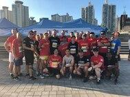 USAG YONGSAN GARRISON, SEOUL – A U.S. Marine Corps Forces Korea team prepares to run the Seoul Night Run here, July 14. The Seoul Night Run included a 5k, 10k, and half marathon road race. (Courtesy photos/Released)