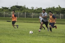 Marines with the 31st Marine Expeditionary Unit play soccer with local Okinawans during a community relations event at Camp Hansen, Okinawa, Japan, June 30, 2018.