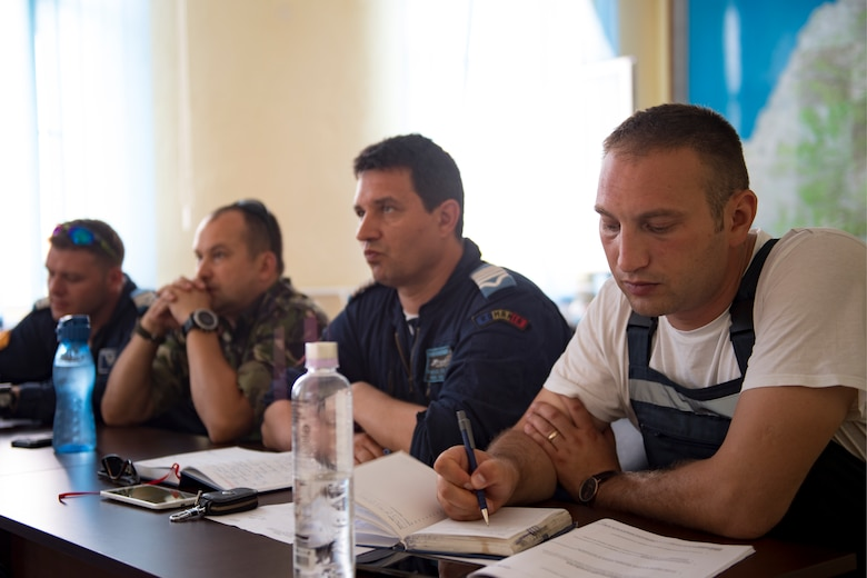 Romanian air force personnel attend a training session with U.S. Air Force supply experts during a three-week engagement on Borcea Air Base, Romania, July 24, 2018. The supply Airmen shared their experiences with the Romanians to give them a different perspective of processes and procedures. (U.S. Air Force photo by Senior Airman Devin Boyer)