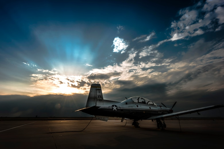 A T-6A Texan II is used to train specialized undergraduate pilots at Vance Air Force Base, Oklahoma April 24, 2018. The Texan has a thrust-to-weight ratio that allows the aircraft to perform an initial climb of 3,100 ft per minute and reach a height of 18,000 ft in less than six minutes. (U.S. Air Force photo by Erik Cardenas)