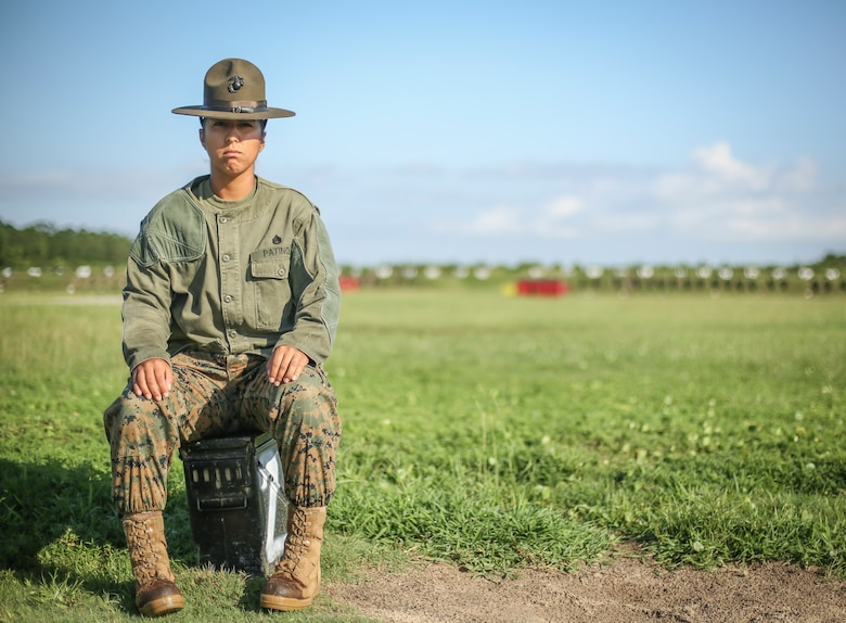 U.S. Marine Corps Staff Sgt. Estefania Patino, a Primary Marksmanship Instructor at Marine Corps Recruit Depot Parris Island, S.C., poses for a photo at Hue City Range July 24, 2018.
