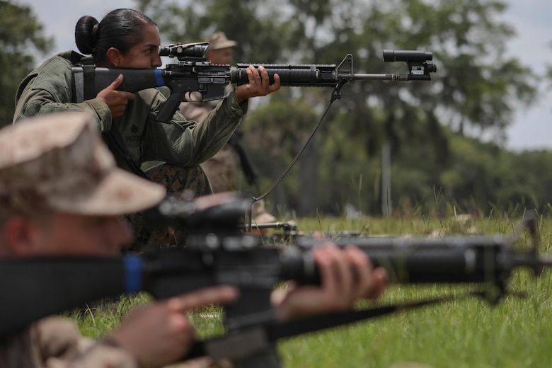 U.S. Marine Corps Staff Sgt. Estefania Patino, Primary Marksmanship Instructor, corrects the rifle combat optic of a recruit's weapon during grass week June 6th, 2018, on Parris Island, S.C. The purpose of grass week is to teach recruits shooting positions and weapon safety rules for Table 1 and 2. Alpha and Oscar Companies are scheduled to graduate July 20th, 2018.