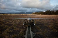 A U.S. Marine Corps RQ-7B Shadow Unmanned Aircraft System assigned to Marine Unmanned Aerial Vehicle Squadron 3, prepares to launch in support of the amphibious landing demonstration as part of Rim of the Pacific exercise Marine Corps Base Hawaii July 21, 2018. The launch was the last flight for the Shadow in the U.S. Marine Corps in which the platform will be replaced with the RQ-21 Blackjack, a technologically superior and expeditionary UAS. RIMPAC provides high-value training for task-organized, highly capable Marine Air-Ground Task Force and enhances the critical crisis response capability of U.S. Marines in the Pacific. Twenty-five nations, 46 ships, five submarines, about 200 aircraft and 25,000 personnel are participating in RIMPAC from June 27 to Aug. 2 in and around the Hawaiian Islands and Southern California.