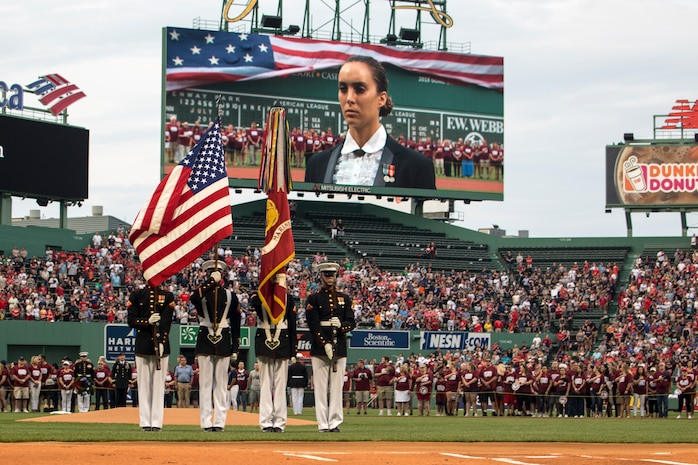 Marines with the U.S. Marine Corps Color Guard carry the Marine Corps Battle Colors and the National ensign during the opening of a Red Sox game at Fenway Park, Boston, Massachusetts, July 28, 2018. The official Color Guard is the only Color Guard that carries the Battle Colors of the Marine Corps.