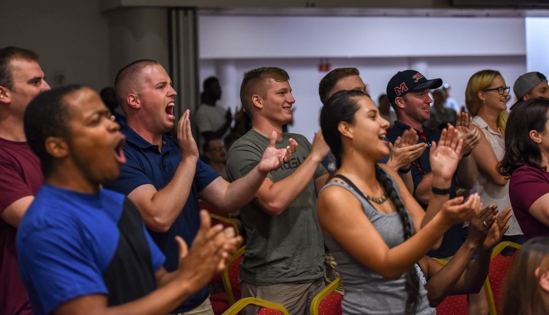 Members of the crowd cheer on contestant