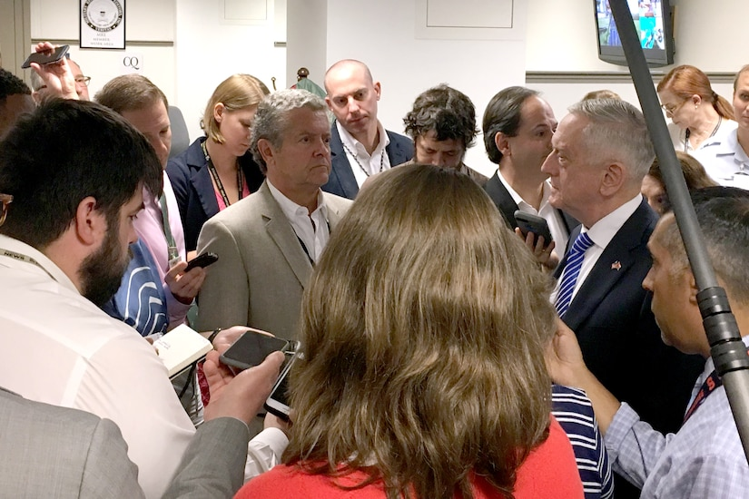 Defense Secretary James N. Mattis speaks to a crowd of people.
