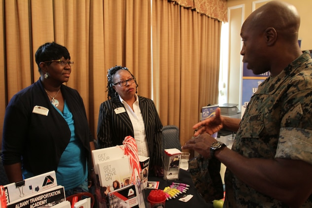 Marine Corps Logistics Base Albany Sgt. Maj. Johnny Higdon spoke with dual enrollment advisors from Albany Technical College during the Military Child Educational Summit, July 24. As the school year quickly approaches, active-duty families aboard MCLB Albany received information about various school districts and educational opportunities in Southwest Georgia. Leaders from both public and private schools showcased their programs. (U.S. Marine Corps photo by Re-Essa Buckels)